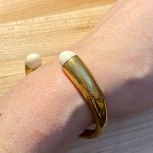 Brass cuff bracelet.